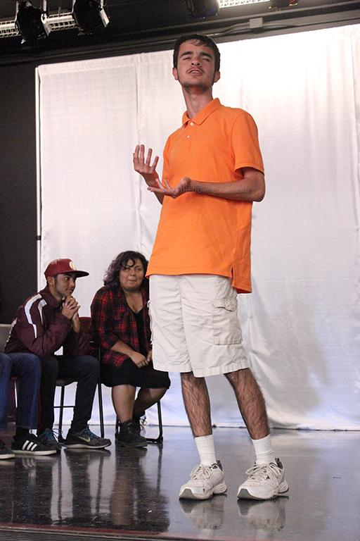 """To practice his improv, James Colom, 10, officially steps on stage for the first time during the Comedy Sportz meeting on October 5. """"I just kind of go with things and see where it takes me,"""" Colom said. """"If it can make people laugh, I'll roll with it, and if I can't, I'll try something else.""""~"""