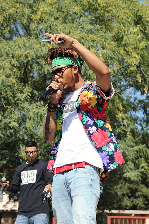 """Getting his inspiration from the crowd, rap artist, Space Boii Fresh, goes crazy during the Troy Noka concert at Downey High School. """"My mind is already focused on giving y'all the advance I got,"""" Space Boii Fresh said, """"but when you guys are reciprocating, it makes me go crazy."""""""