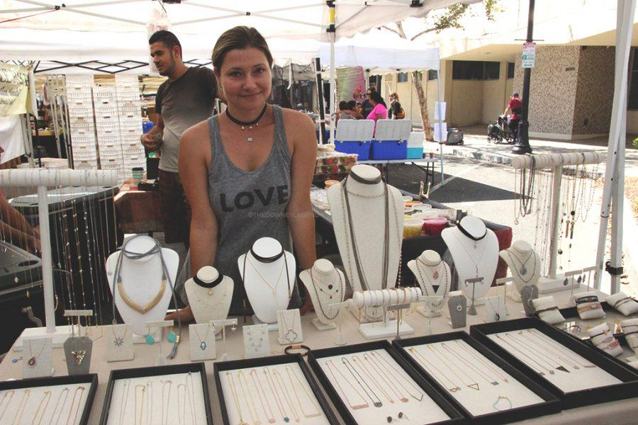 """At the farmers' market on 3rd Street, on October 1, vendor Lisa designs and sells her jewelry to make money. """"I design the jewelry myself,"""" Lisa said. """"The Haus of Accessories manufactures them."""""""