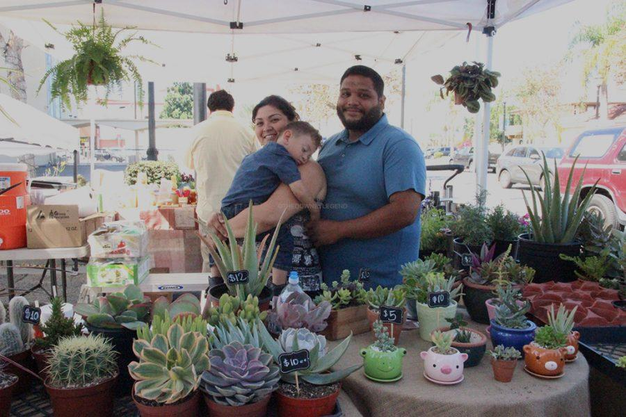 On 3rd Street, during the farmers' market in Downey, on October 1, Oscar and Lucia Vargas, along with little Benjamin, work to sell their self-grown plants. They have been working together at multiple farmers' markets for six months.