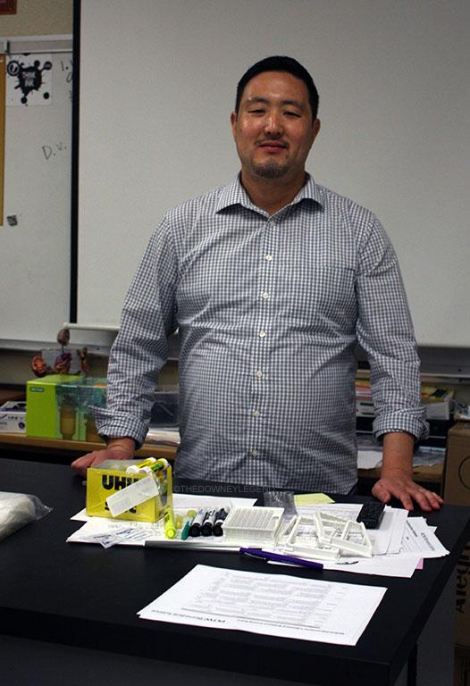 """Starting off class with Think with Ink activity Mr. Hwang, a Biomedical Science teacher at Downey High School, poses at his desk in the X building ready to start the new school year with a creative, hands-on environment. """"Think with Ink is embedded into the program, so basically whatever you're doing, it's a hands on class,"""" Mr. Hwang stated. """"So for example, they did a lab today where they have to come up with a claim and they have to do problem solving and they have to collect data and come up with a conclusion."""""""