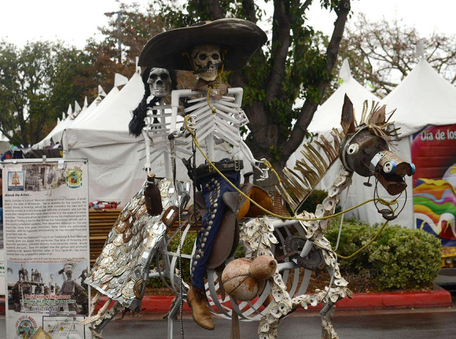 At the Dia De Los Muertos Festival at the Downey Civic Theatre on Oct. 30, an art sculpture created by artist, Martin Sanchez, is displayed. The sculpture was made using recycled can lids, soda cans, and other recycled materials.