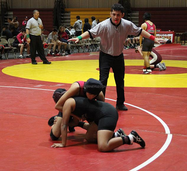 """During the girls wrestling match on Saturday, Dec. 3, Ariana Reyes, 10, puts up a fight against one of the Bell Garden teammates resulting in a win. """"Well, I was nervous at first, everybody was. It was our first match of the season,"""" Reyes said. """"I felt kinda confident going out there knowing that I have wrestling experience."""""""