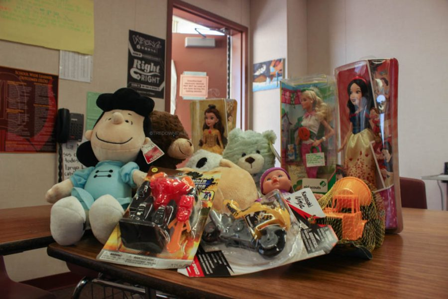 Mrs. Cuba encourages students to donate toys for hospitalized children from ages three to eight. The toy drive started with one toy in her fourth period and has now become a box full with stuffed animals, toy cars, and dolls.