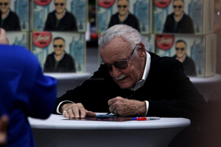 After making his entrance at L.A. Comic Con, Marvel co-creator and comic artist Stan Lee sits down at his personal booth to sign comics for his fans.