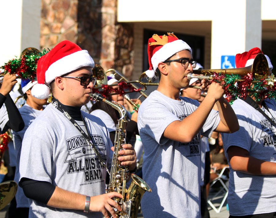 Marching down 3rd Street on Dec. 3, the All District Band plays for the people of Downey for the annual Christmas parade. The group of performers consist of students from both Warren and Downey High School's band who were invited to show off DUSD's talent.