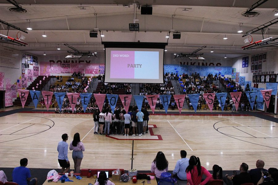 Student volunteers compete against each other on games created by ASB and associates. In this picture boys and girls played riff-off, a game in which both groups were given the same word and they would sing a song that contained that word.