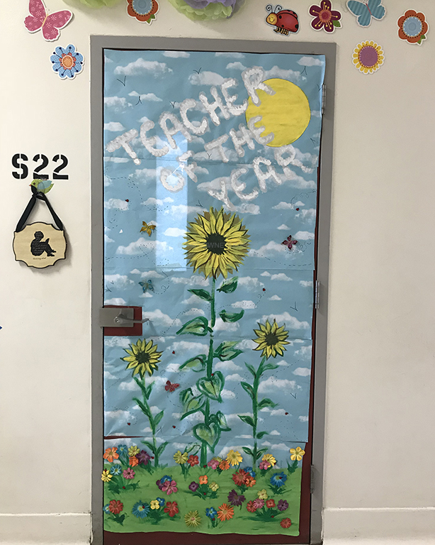 After getting awarded teacher of the year, Mrs. Carlson and Mrs. Bean's teacher assistant, Mia Mohr, 12, spent hours together decorating Carlson's classroom door. Previous students of Carlson have followed her footsteps by becoming teachers, such as Mrs. Patterson and Mrs. Barbeau.