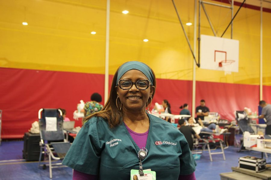 """While checking up on patients, Nurse Gina Davis explains why the blood drive on September 27, at Downey High school is so important. """"The blood drive saves lives,"""" said Davis. """"People who get into car accidents or are in surgery need blood and when student's donate, they're saving a life."""""""