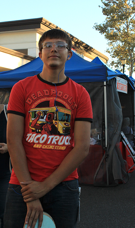 """Walking around the Food and Music Festival on Downey Ave between 4th and 5th, Johnathon Arias, 12, talks about how much he enjoys coming to the festival for the past six years, on Sept. 15. """"The festival is a good way to get the community out and talking to each other,"""" Arias said."""