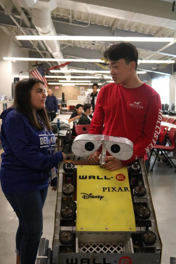 """Discussing the progress of their robot in their aerospace and engineering room, seniors Malena Merlos and Simon Choo, check up on their Wall-e robot on Oct. 26. """"I've always been interested in engineering,"""" Merlos said. """"It's not until I took Mr. Yamasaki's engineering physics class that I was able to fully immerse myself into engineering and commit to things like robotics."""""""