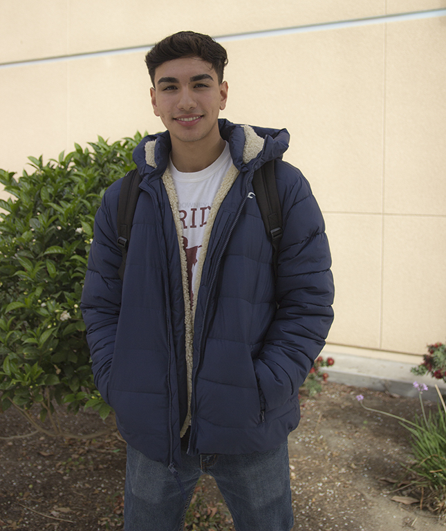 """A blue Hollister winter coat was given to Eddie Amato, 12, from Tristan Yepez, 12, because Yepez was challenged to prank someone on Halloween to earn the brands gear. """"They threw a pie to my face and then pushed me into Tristan's pool."""" Amato said. """"It was super freezing man, but, hey, this coat is warm and [very] stylish."""""""