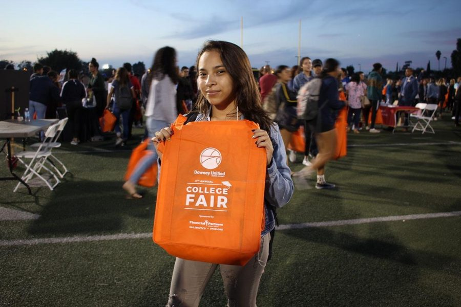 "Wanting to find more information about various colleges, Emely Velasquez, 12, attended the DUSD College Fair on Oct. 23 at the Allen Layne Stadium. ""The college representatives were there to answer any questions I had,"" Velasquez said. ""The representatives helped inform me about their colleges."""