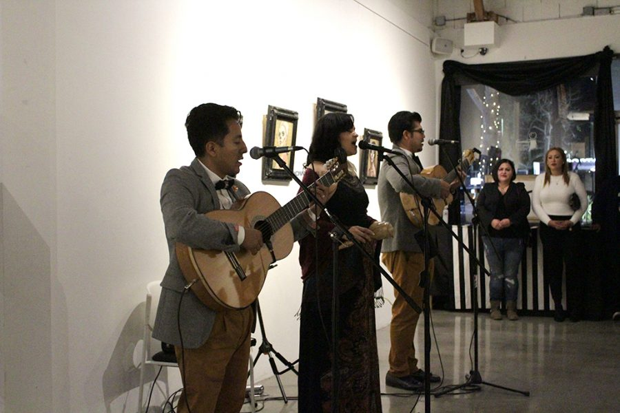 """A big part of the romantic setting at Stay Gallery that complemented the Love Letters theme was the group, Tres Souls with main vocalist Rocio Mendoza, who spent most of the night playing boleros. """"It's nice and chilly outside but it's nice and warm in here with music and community and art and family,"""" Mendoza said."""