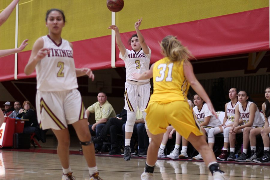 Attempting+a+three-pointer+in+the+Downey+High+School+gym+on+Feb.+7%2C+Leila+Garcia%2C+11%2C+shares+how+the+energy+from+the+fans+pushes+her+to+play+her+best.+%E2%80%9CIt%E2%80%99s+a+lot+of+positive+energy%2C%E2%80%9D+Garcia+said.+%E2%80%9CThe+chants+that+the+fans+do+bring+up+the+hype+in+our+games.%E2%80%9D