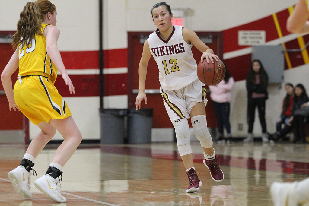 Executing+a+play+against+the+Ventura+Cougars+on+Feb.+7+in+the+Downey+High+School+gym%2C+Kaylie+Lara%2C+11%2C+discusses+how+this+season+has+helped+her+and+her+team.+%E2%80%9CThis+year+we+are+a+lot+closer+as+a+team%2C%E2%80%9D+Lara+said.+%E2%80%9CWe+learned+to+play+better+together.%E2%80%9D