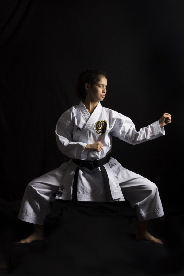 """Posing the circle block, Teresa Martinez, 12, loves to compete in tournaments. """"My favorite part about karate is the rush I get when competing,"""" Martinez said. """"Because win or lose, it's all about the experience. My passion for this sport gives me the drive to always do better."""""""