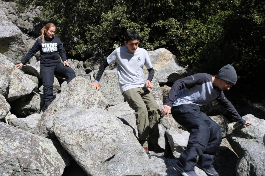 "One of the challenges AP Environmental Science students faced on their trip to Yosemite from Jan. 21-25, included climbing various rocks in a mountain which Juan Rosa, 12, helped the students behind him with. ""It was difficult climbing up and down the rocks,"" Rosa stated. ""But I realized it wasn't so bad because everyone was relying on the person in front of them with telling them where to step, so it required a lot of teamwork."""