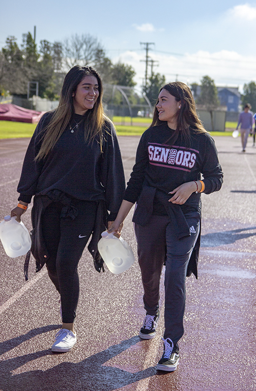 On+Jan.+9%2C+Downey+High+School+hosted+the+charity+event%2C+Walk+for+Water.+Seniors+Jackie+Moreno%2C+and+Cynthia+Orellana+walk+numerous+miles+to+show+their+support+for+the+cause.+%E2%80%9CI+had+fun+being+a+part+of+something+and+doing+my+part%2C%E2%80%9D+Orellana+said.+%E2%80%9CI+find+it+crazy+that+little+things+like+water+are+taken+for+granted+while+people+around+the+world+suffer+for+it.%E2%80%9D+