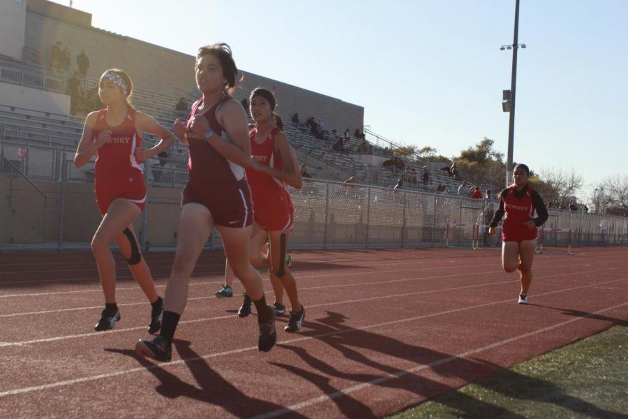 """Running 100 meter hurdles, Eliana Ponce, 10, competes against her own team for first place.  """"It's really fun and interesting and you get to like learn a lot of new stuff and new techniques,"""" Ponce said, """"I think I did pretty good because I usually don't do the best but it was just us [Downey] so I was pretty comfortable."""""""