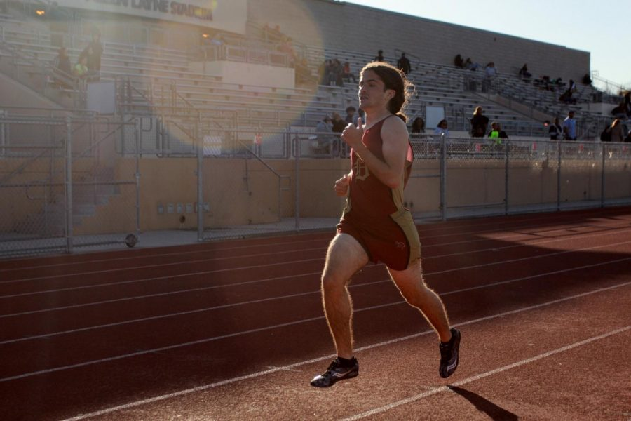 """As a part of the Downey High School track team Alex Bourgeault, 11, runs 100 meters against Lynwood and Dominguez. """"I wanted to stay physically active"""" Bourgeault said. """"And I like competitive atmosphere pretty much, and the adrenaline rush."""""""