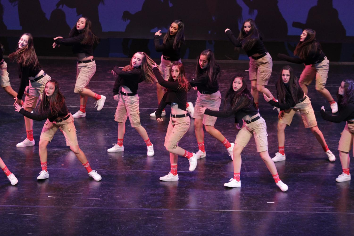 A+member+of+the+Downey+High+School+dance+team%2C+Chloe+Gonzales%2C10%2C+performs+a+stage+titled+Big+Shot.+%E2%80%9CI+think+it%E2%80%99s+important+because+it+boosts+other+dance+team%E2%80%99s+confidence%2C%E2%80%9D+Gonzales+said.+%E2%80%9CWe+get+to+share+dance+as+a+whole+and+speak+with+one+voice.+So+many+cities+are+coming+together+to+share+their+passion+of+dance+and+we+all+get+to+enjoy+each+other.%E2%80%9D