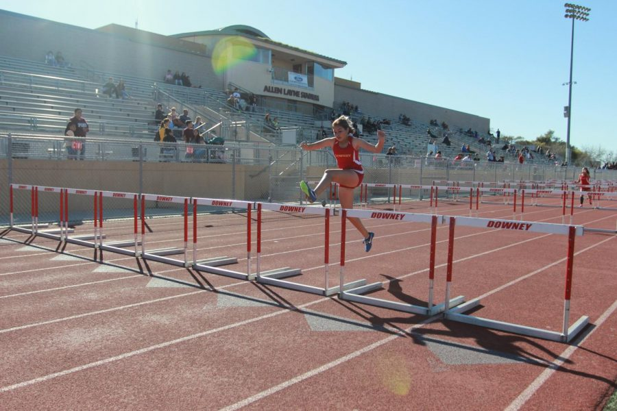 """An 800 meter varsity runner in the Downey High School track team, Katia Arriaga, 11, competes against Lynwood and Dominguez on March 13. """"You make friends that become family,"""" Arriaga said. """"You feel a sense of accomplishment after each and every run."""""""
