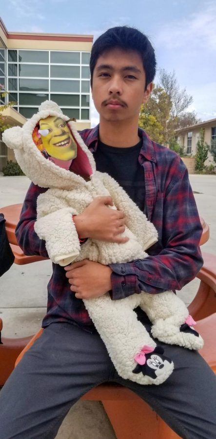 """For an AP Psychology project at Downey High School, Jeff Lucena, 12, creates a bottle baby named Shrek and gives insight on parenting. """" Parenting isn't always what it seems,"""" Lucena said. """"You'll never knows what you're going to get, so just be thankful that you're giving someone else a chance."""""""