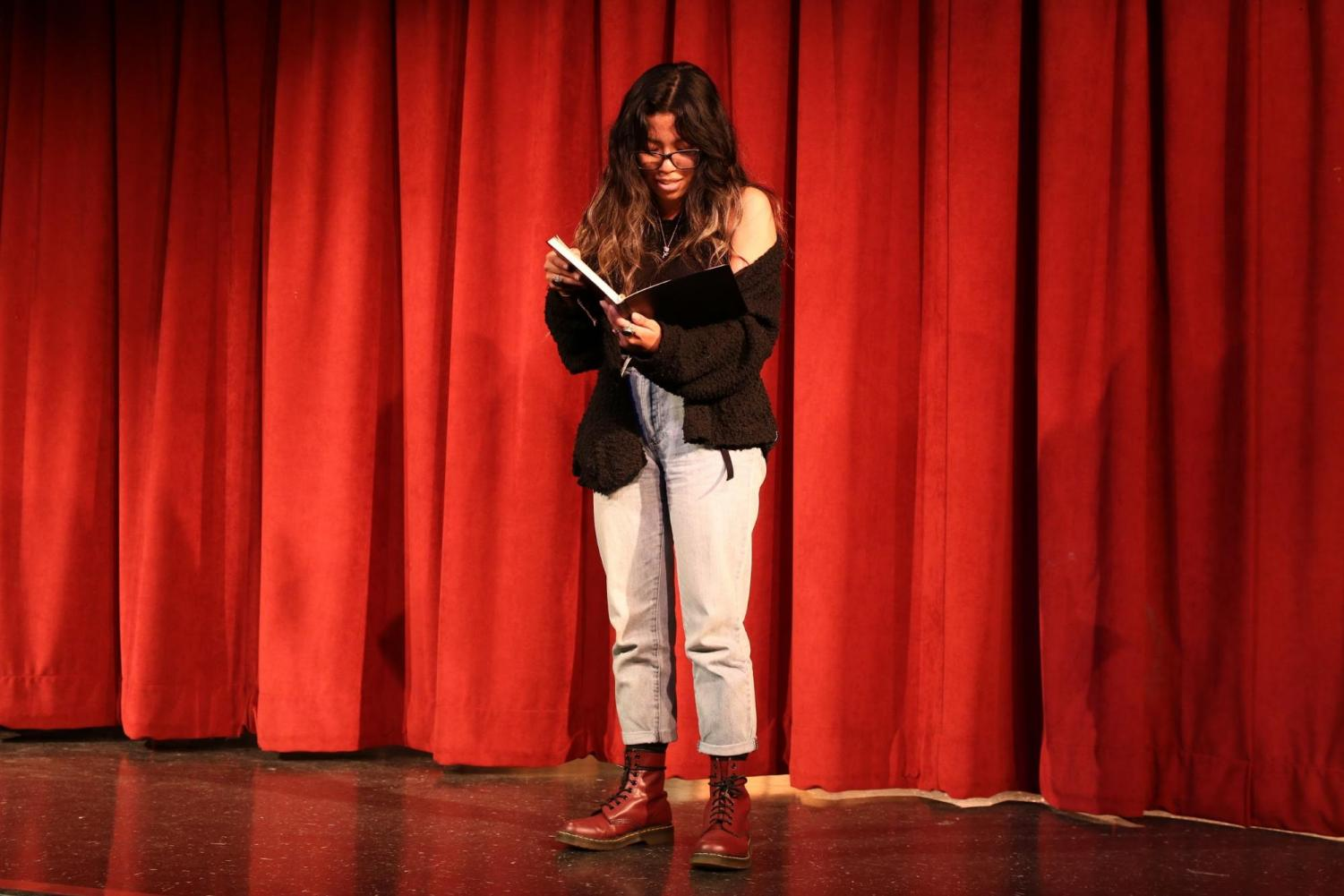 Junior+Lizzeth+Aguilar+performed+her+Untitled+original+poem+during+the+Poetry+Slam+on+Feb.+28+in+the+DHS+Theater.+%E2%80%9CAt+first+I+was+nervous+but+I+kept+reading+and+kept+going%2C%E2%80%9D+Aguilar+said.+%E2%80%9CAs+I+kept+reading%2C+I+actually+felt+that+performing+was+a+peaceful+way+to+express+what+I+feel.%E2%80%9D
