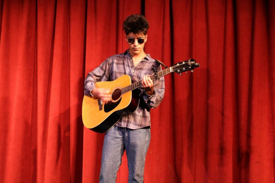 "On Feb. 28, Julian Martinez, 12, performed an original song during the third annual Poetry Slam in the DHS Theater. ""I felt very comfortable when performing,"" Martinez stated. ""I focused on my guitar and pretending to practice by myself, so it was really easy to be in front of so many people."""