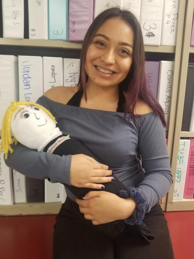 """For AP Psychology's 3rd quarter project, Ivy Solana, 12, created her bottle baby son, Cornelius the 3rd, in order to get herself a good grade. """"I had a lot of fun making this baby,"""" Solana said. """"I also think this project helped me learn and memorize more about psychological development a lot more as well."""""""