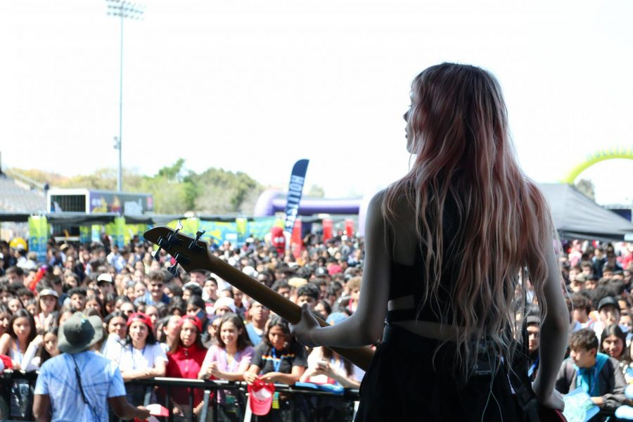 On stage performing with her band, Crimson Apple, bassist Carthi Benson plays for the students of Downey High School at High School Nation's 2019 Tour on Mar. 31. The Benson sisters grew up in Hawaii and moved to the big city of Los Angeles where they now write, play, and rehearse their music.
