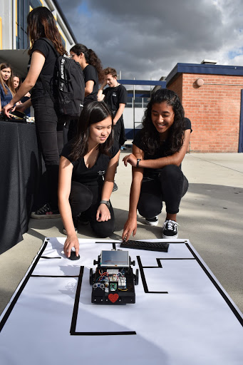 """Demonstrating all they have learned since joining Femineers, Alyssa Chan, 11, and her partner Olivia Baltazar, 11,  successfully programmed their robot to navigate a maze at the Femineers Gala on Mar. 21. """"My favorite project is the wearable technology project that we did last year,"""" Chan said. """"That one was a lot of fun because I got to express my creativity and work with my friends."""""""