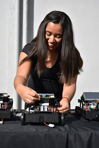 """At the Femineer Gala on March. 21, Stephanie Vaca, 12, programs her robot to travel in a circle. """"I joined Femineers because engineering is something I would like to major in the future,"""" Vaca stated. """"By joining Femineers, I have been exposed to some of the basics of engineering that I wouldn't get anywhere else."""""""