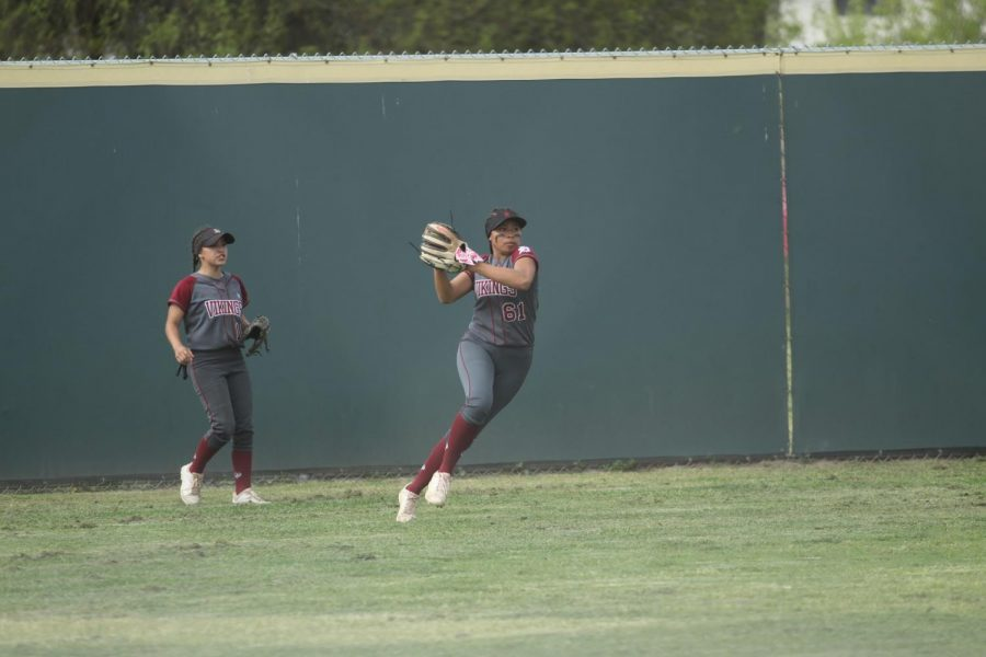 """Attempting a double play after a pop fly during the game in the softball field on April 4, Jayleen Torres, 12, gives her insight on how being a part of the team has changed her. """"Being a part of this team has made me a better person and a better softball player, it has taught me a lot of things,"""" Torres said. """"It has helped me overcome so many problems and basically just made a whole new person with my attitude and my love for the game."""""""