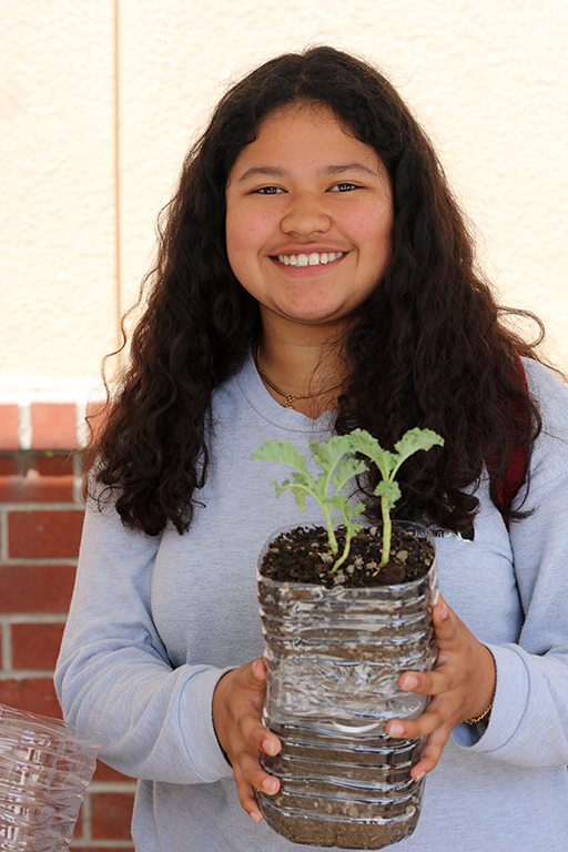 """Spreading the word to her peers about the importance of being eco-friendly, Tori Quinones, 11, enjoys seeing the students of Downey High stop by the table to get involved with their ecosystem. """"It really does make our club members happy to see that we were able to accomplish and plan this entire week,"""" Quinones said. """" I personally loved seeing the amount of students actually interested in hearing what we had to say about our club."""""""