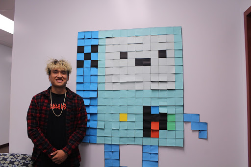 "Enjoying computer design, Jermey Ortega, 12, is loving the class and bringing that love into Post-it art. Ortega along with three other students completed BMO, a cartoon character, ""it was such a cool experience, we struggled to put it together but we overcame the challenge,"" Ortega stated."