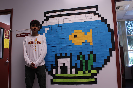 """With the new Post-it Art, started by computer design, Miguel Solis, 12, was really fond of the project. Even with the challenge it did face, """"it was fun but it was also challenging,"""" Solis stated, """"We had to measure and be symmetrical, it was a slow process but it was worth it."""""""