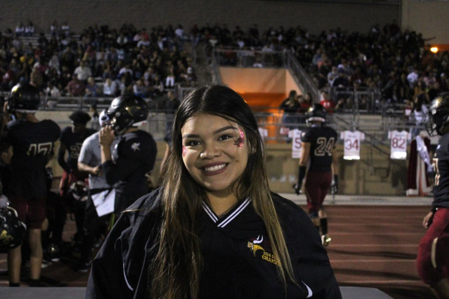 """n ASB member and on duty Sports Medicine, Carla Chafloque,12,  roots for Senior Princess, Tammy Abad to win Homecoming Queen. Chafloque went to the homecoming game to make as many memories as she can before she graduates. """"It's my last year,"""" Chafloque continued, """"Making it memorable with my friends! Homecoming being the only dance until prom makes me ten times more excited."""""""