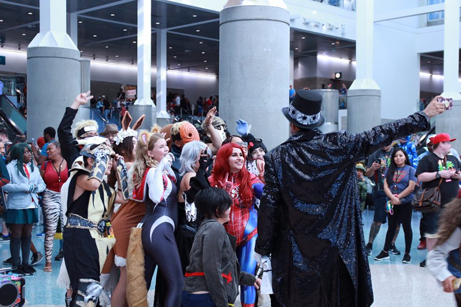 People tend to let themselves unwind and have fun at such a big convention like Comic-Con. Having just danced to Thriller, by Michael Jackson, amongst two or three other songs and they all posed for a group picture.