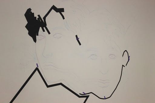 """The tape mural in its early form with only the sketch and some tape placed on it can be seen, the photographed few days old work belonging to sophomores Anisa Chacon and Diana Curiel. """"The design seemed easy enough at the time,"""" Chacon said, """"The tape kept unsticking from the wall, it was hard to get it to not fall off."""""""