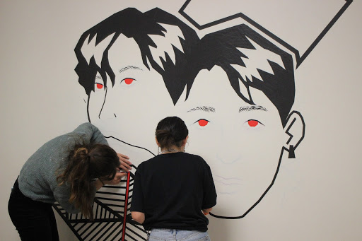 """Some progress on putting the major details with the tape on Chacon and Curiel's Mural. """"No one else had done it,"""" Curiel said, """"I wanted to do something unique or different and somewhat challenging."""""""