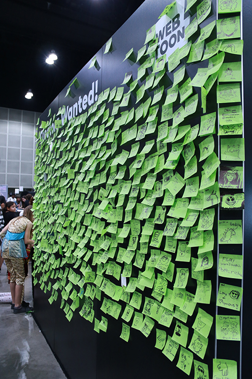 Webtoon is a growing platform for aspiring artists to publish their stories and have their talents be discovered. The company used Comic-Con as a chance to scout out other people with the same potential many others have shown by letting people put their art on sticky notes and sticking it on the wall they put up.