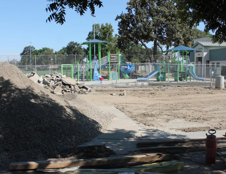 """The piles of dirt and rubble surround what is known as the Apollo Park playground, a temporary eyesore to what will later be replaced by an even better park for people to enjoy with new picnic tables, picnic shelters, restroom improvements, and new field lights. """"We really havent upgraded our parks since they were built,"""" Ashton said."""