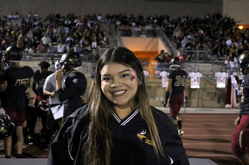 """An ASB member and on duty Sports Medicine, Carla Chafloque,12,  roots for Senior Princess, Tammy Abad to win Homecoming Queen. Chafloque went to the homecoming game to make as many memories as she can before she graduates. """"It's my last year,"""" Chafloque continued, """"Making it memorable with my friends! Homecoming being the only dance until prom makes me ten times more excited."""""""