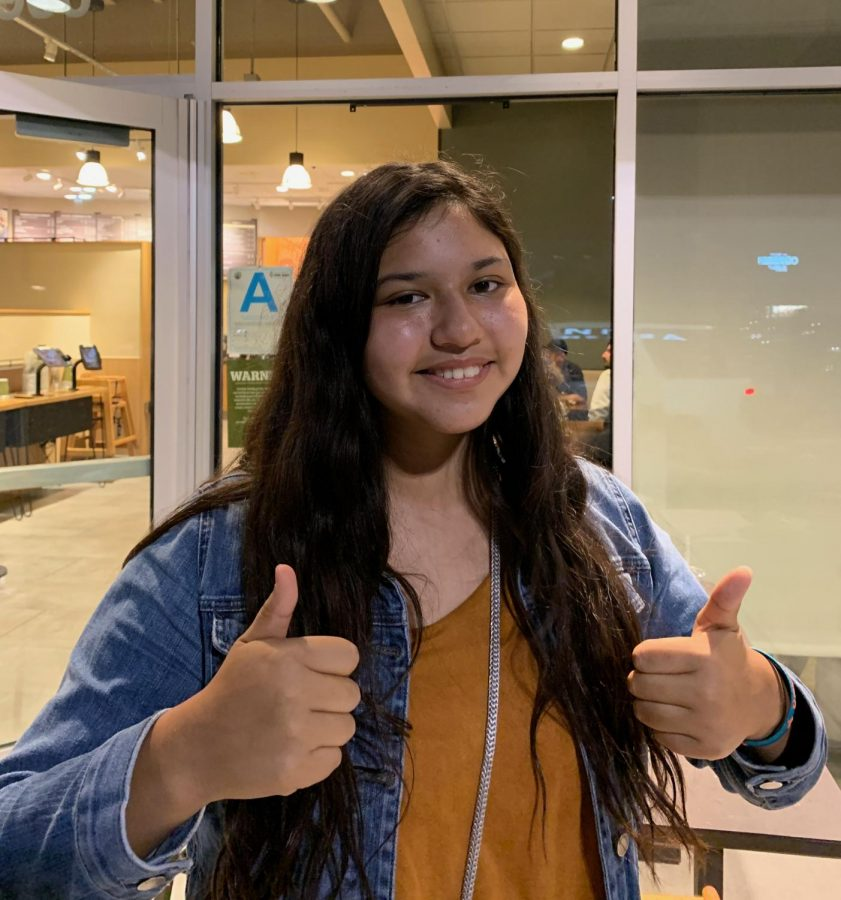 """At Deaf Chat Night, Alexa Gomez, 9, spent her evening at Panera bread to interact with deaf people of different ages to welcome them. Gomez is not an ASL student who still wants to make a difference in the community by involving deaf people. """"Honestly it just shows us to be more compassionate, like shows us to be more caring,"""" Gomez stated."""
