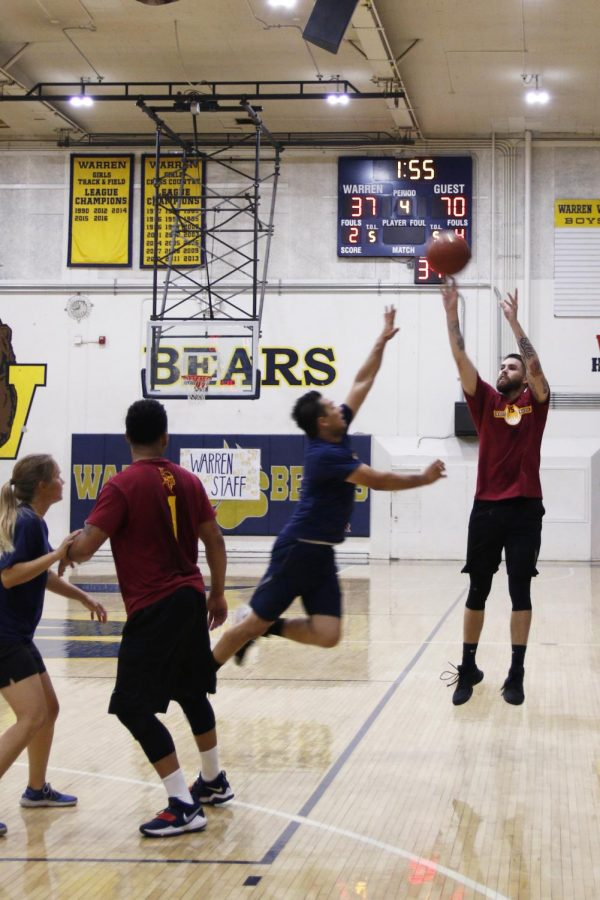"""Playing throughout high school and college, Coach Ellis, freshman basketball coach, leading the team to victory against the Warren bears. """"I have played for Downey and never lost to Warren, and I am not losing right now,"""" Ellis stated """"Downey for the win!"""""""