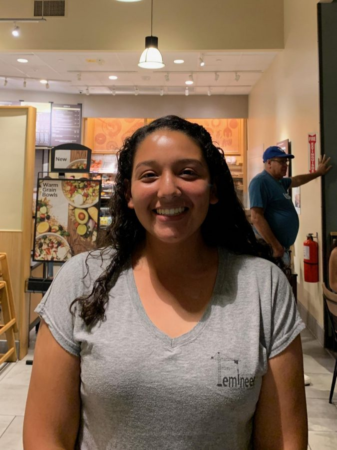 """An American Sign Language student, Emily Ayestas, 9, attends Deaf Chat Night at Panera Bread on October 5 to make a difference in the community. """"It allows us to interact with other people and it opens our eyes and mind to a different world,"""" Ayestas stated."""