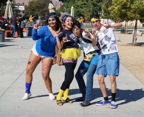 "Following tradition, seniors, Jenna Meza (Left), Natalie Mejia (Middle left), Julian Yepez (Middle right), and Isaac Corella (Right) dressed up for Warren Wimp Day for their last time. ""I honestly felt so sad when it hit me that this would be my last Warren Wimp Day,"" Meza said. ""Spirit Week has always been so much fun and I'm so lucky to have such a hyped student body."""