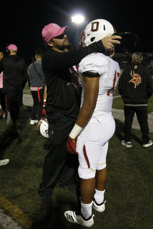 """Preparing to be subbed into the game, Senior Jaden Allen is motivated by his coach to dominate the Bears' defense. """"My coach was telling me what to expect from the defense before sending me out,"""" Allen said. """"I couldn't wait to get back onto the field, I felt like nothing could stop me."""""""